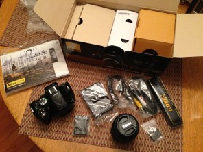 Contents. Manuals, camera, battery and charger, 18-55mm lens, cables and strap.