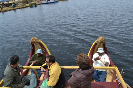 Local men row the reed boats for the tourists