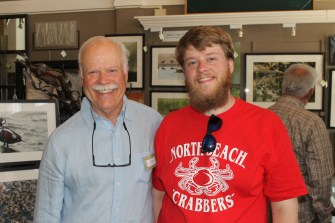 Artist Paul Brent and a member of North Beach Crabbers.