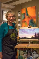 Gretha Lindwood posing with completed pastel painting.