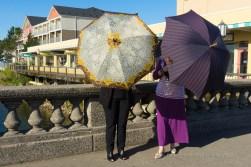 """Ladies! Umbrellas above your heads."""