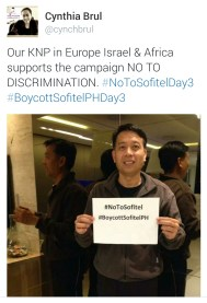 Katulong ng Pangangasiwa (Helper of the Ministry) assigned to the Europe and Africa divisions Bro. Sonny Catan holds up a sign featuring his support of the boycott.