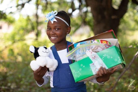 Girl holding shoebox
