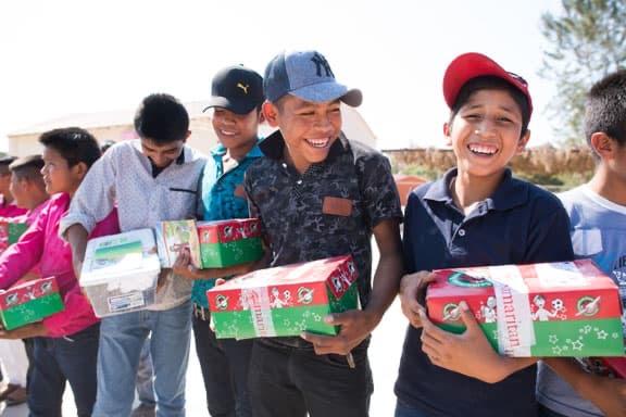 Boys holding shoebox