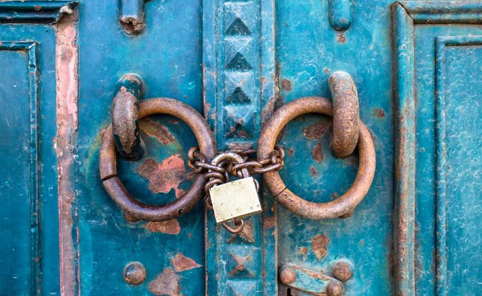 blue doors locked with a padlock