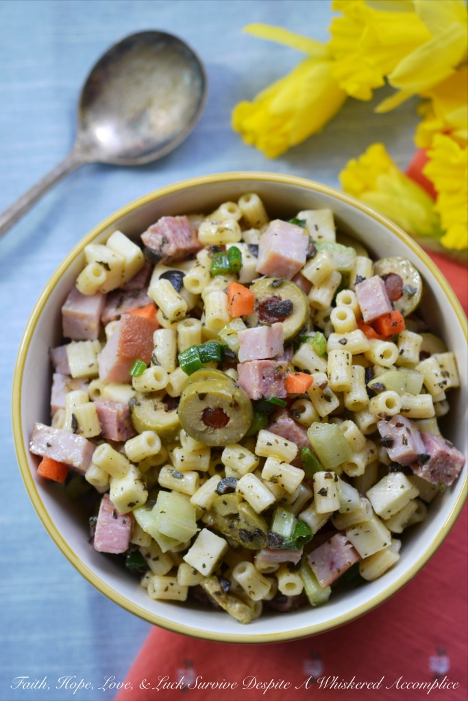 A crowd-pleasing pasta salad, chock full o' the good stuff, including ham, genoa salami, provolone cheese, and lots and lots of olives.