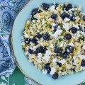 Fresh corn, plump blueberries, and feta cheese come together to make the perfect summer salad when combined with a white balsamic dressing.