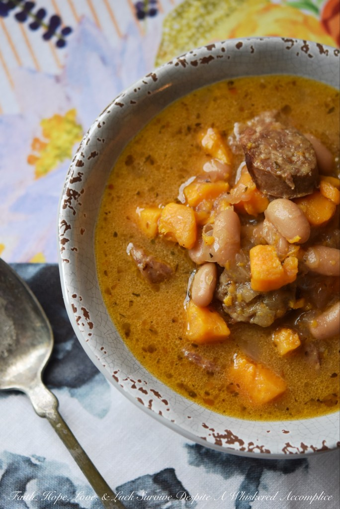 This bratwurst slow-cooker soup containing cannellini beans and sweet potatoes has just the right amount of Cajun kick with just a touch of sweetness.