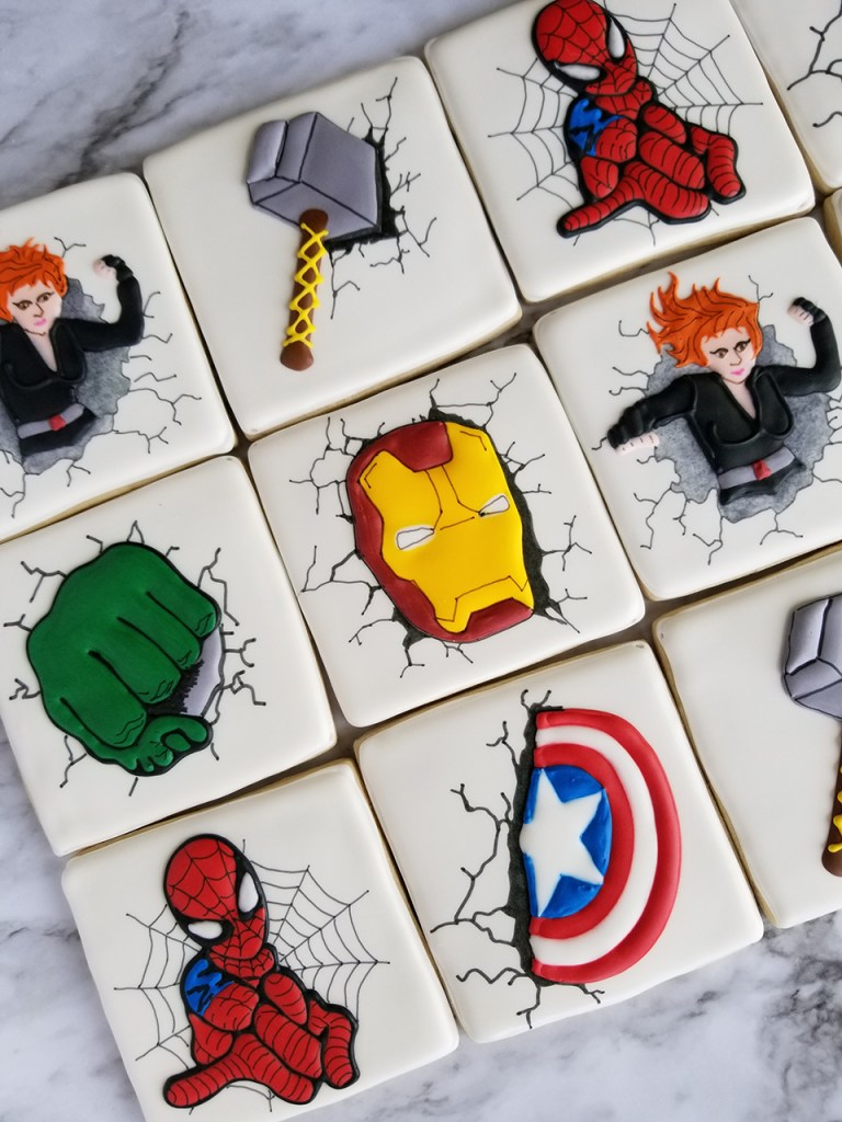 Assorted superhero decorated sugar cookies