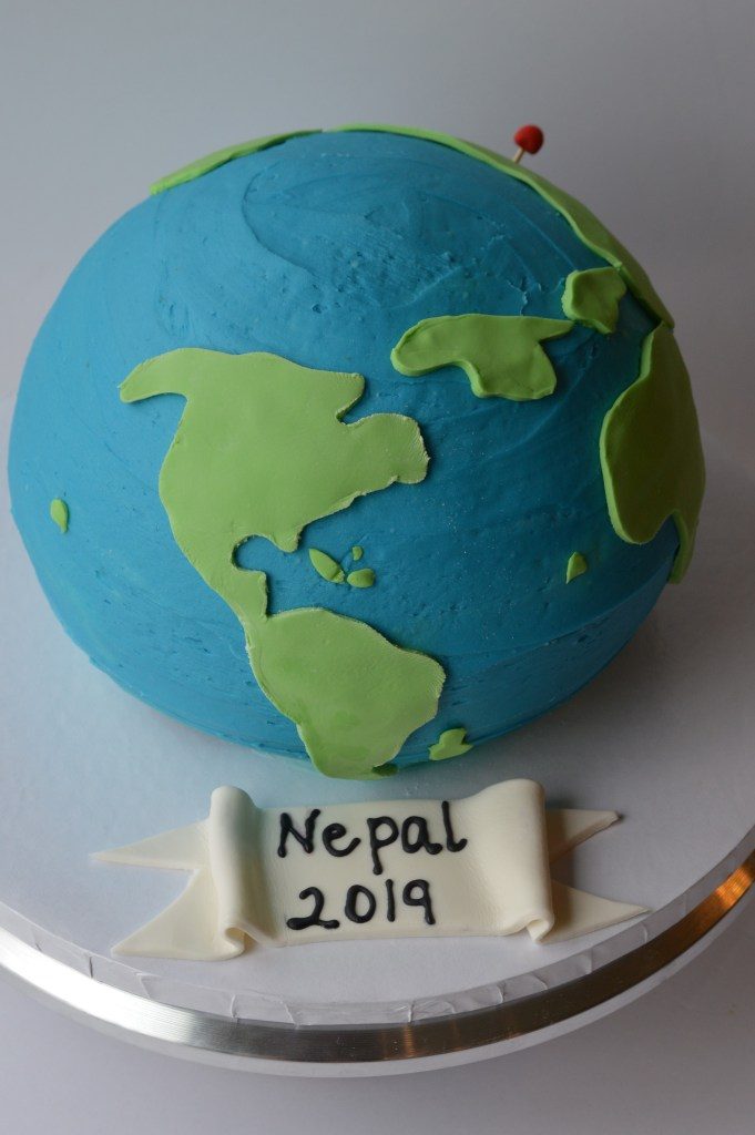 Globe cake with fondant banner.