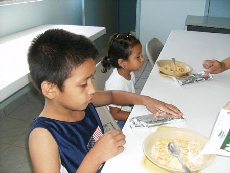 A child eating a meal at the nutrition program in Mexico