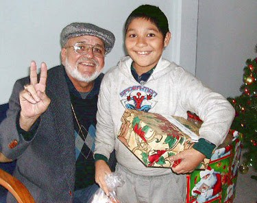 Deantin and a boy with his new gift at a Christmas fiesta in Mexico