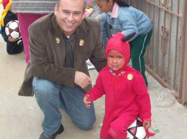 David and a little boy at a Christmas fiesta in Mexico