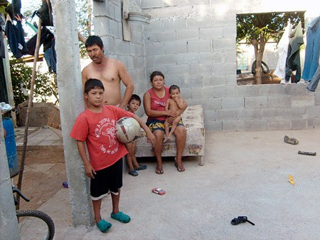 A family in their new Faith Ministry home in Mexico