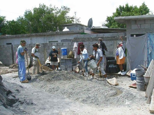 A small team and volunteers working on a house in Reynosa