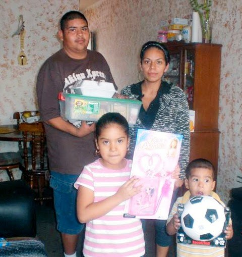 A family with Christmas gifts