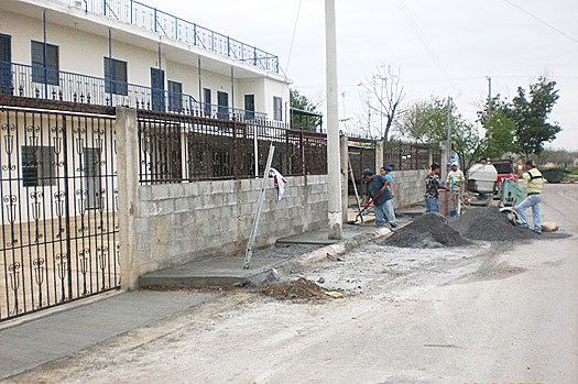 Pouring a sidewalk outside the Miguel Aleman complex