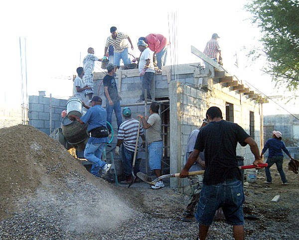 Working to pour a roof in Mexico