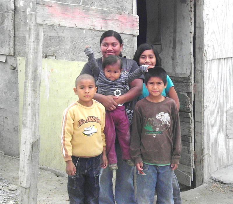 A family receiving a home in Mexico