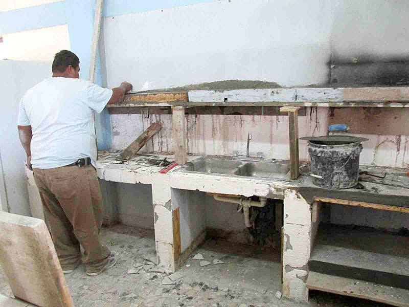 Making repairs to the kitchen at the Reynosa complex