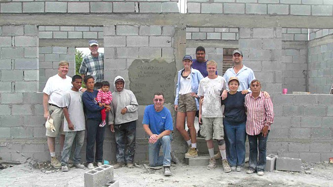 A team and a family in front of a completed house in Mexico