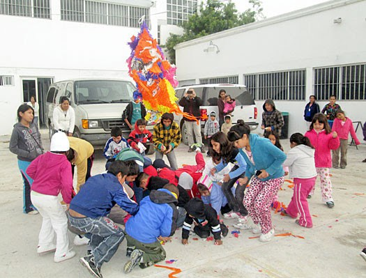 Kids having fun with a pinata at the Christmas fiestas in Reynosa