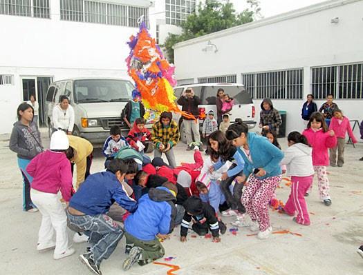 Kids having fun with a pinata at the Christmas fiestas in Reynosa