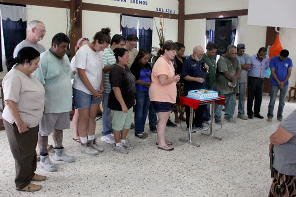The Board praying over the staff at the 21st anniversary