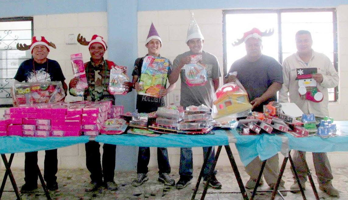 Staff and volunteers ready to give out toys at the Christmas fiestas