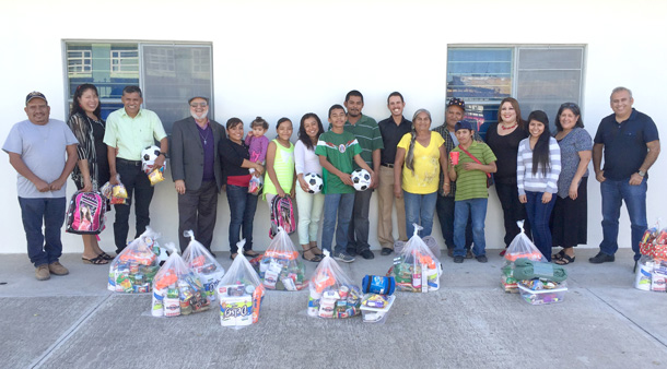 Volunteers and staff with their Christmas groceries in Miguel Aleman