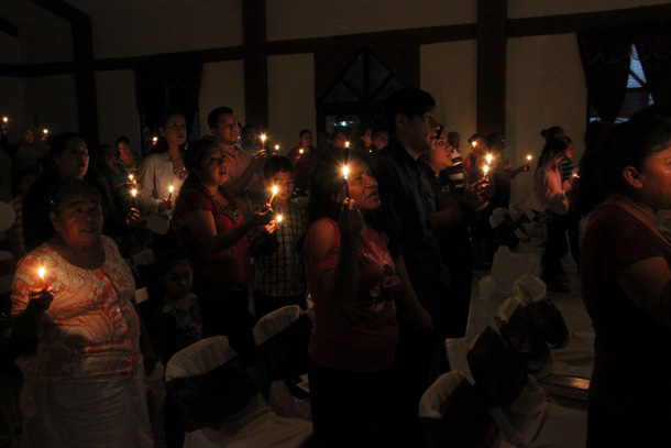 Singing Silent Night by candelight at a Christmas fiesta in Reynosa