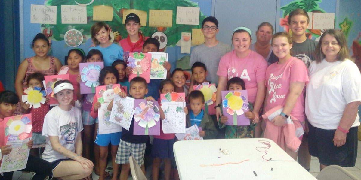 A team doing crafts with the kids in the nutrition program at the clinic in Reynosa