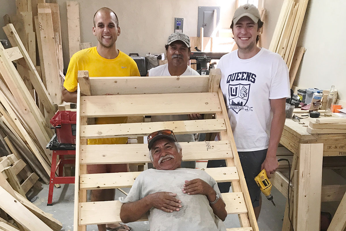 Friends working together in the woodworking shop in Reynosa