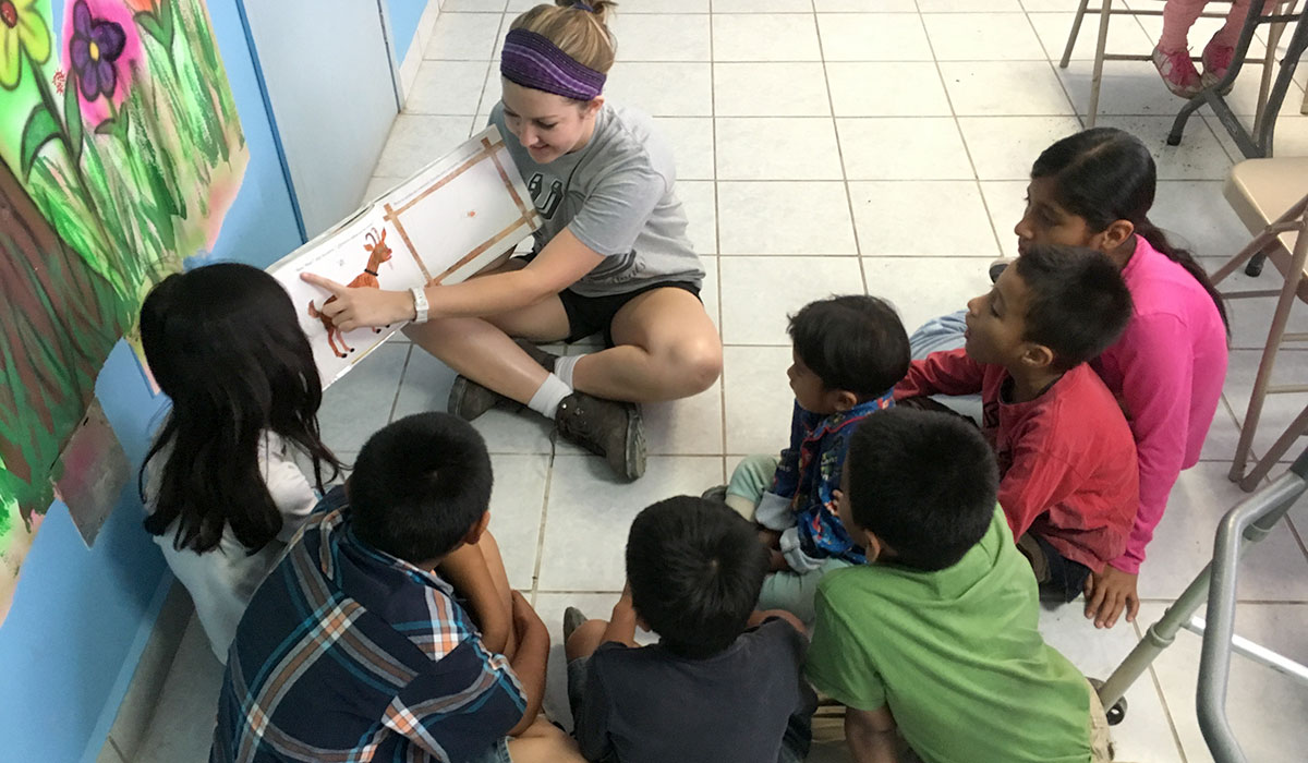 Our intern Gracie reading to the kids in the nutrition program in Reynosa