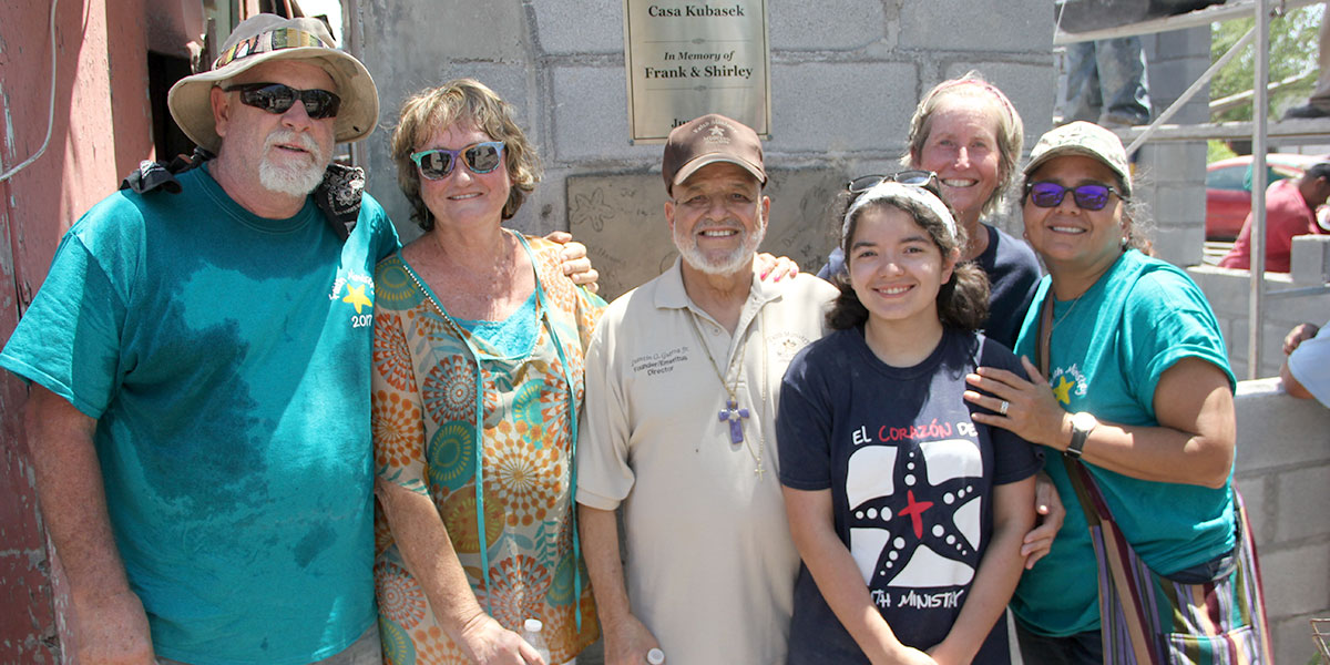 Deantin and his family and friends in front of a completed house in Reynosa