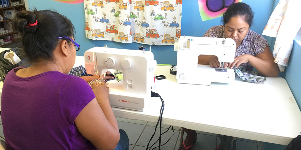 Women learning to sew in the sewing program in Reynosa