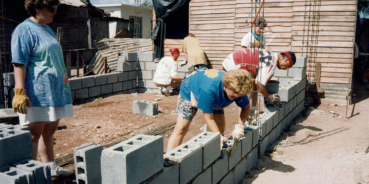 A team from Indiana laying block to build the first Faith Ministry house in 1994