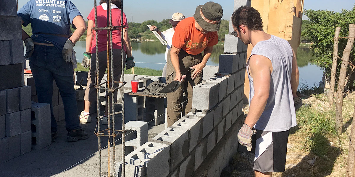 The same team from Indiana laying blocks to build a house in Mexico 22 years later