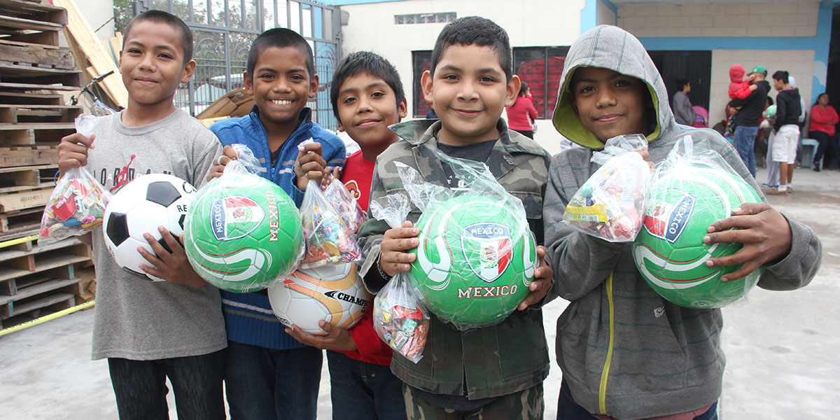Young boys with their new soccer balls at the Christmas fiesta in Reynosa
