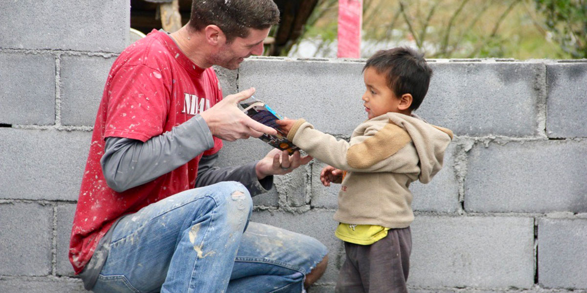 A team member and a little boy sharing a special moment in Reynosa
