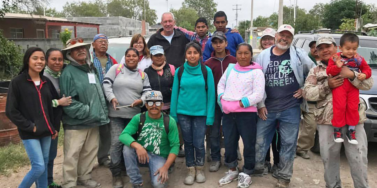 Friends from the US and Mexico working together in Mexico