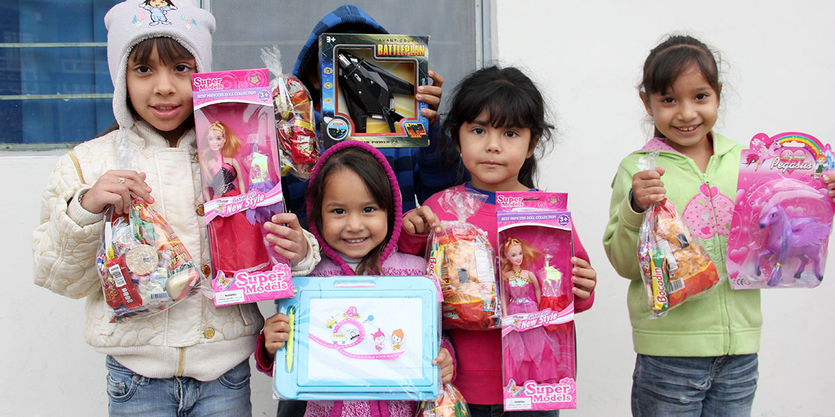 Kids in Miguel Aleman with their new toys from the Christmas fiesta