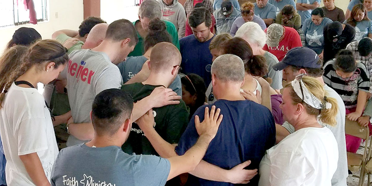 A special time of prayer at the dedication service in Reynosa