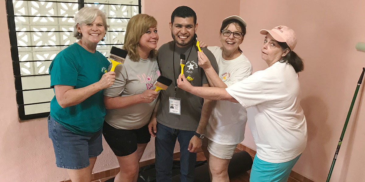 The Board of Directors giving Carlos pastoral house a fresh coat of paint