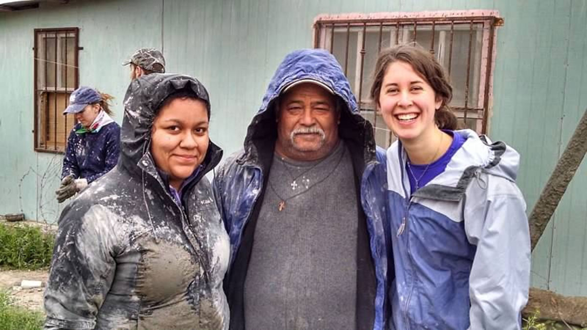 Elizabeth and her friends after pouring a roof in Mexico