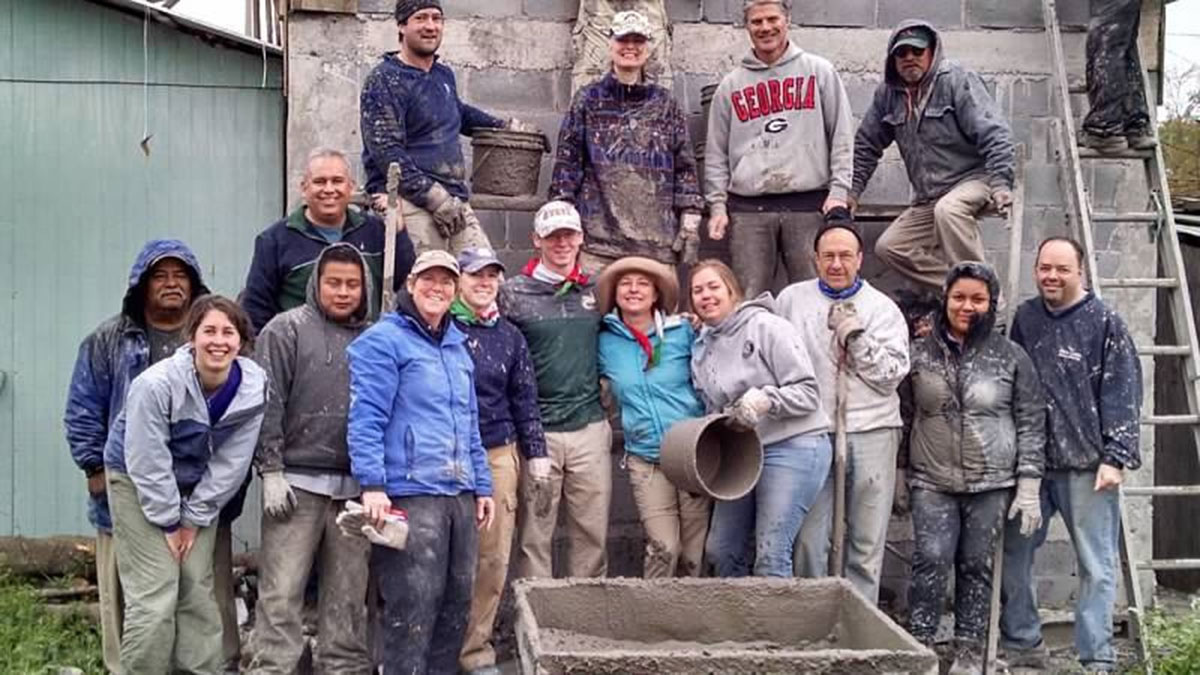 A mission work group after pouring a roof in Reynosa