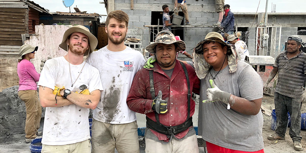 Intern Luke with his fellow intern George and friends Juan Carlos and Hector in Reynosa