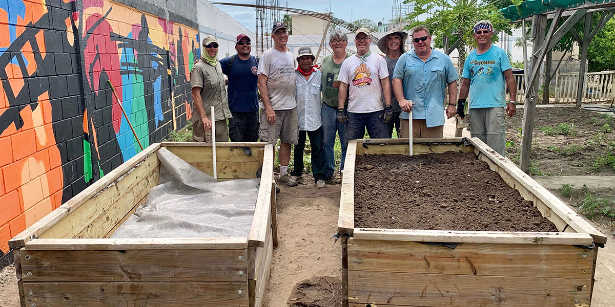A team from Texas with our garden caretaker and the wicking beds they installed in our garden in Naranjito