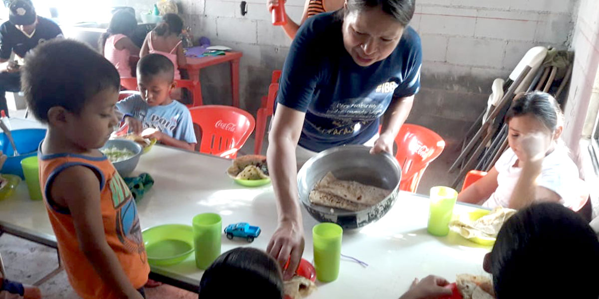 Feeding children at our mission outside of Miguel Aleman