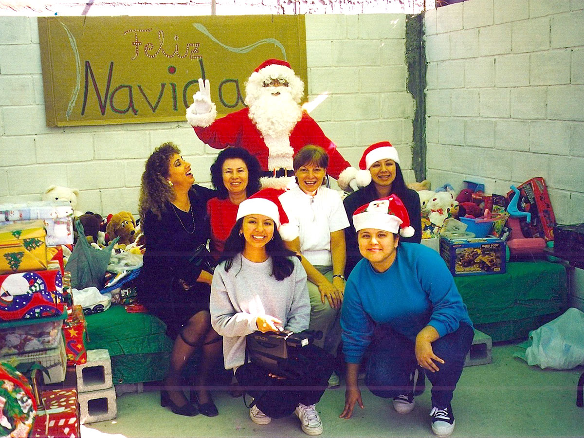 Celebrating at our Christmas fiestas in 1999 with Deantin dressed up like Santa Claus